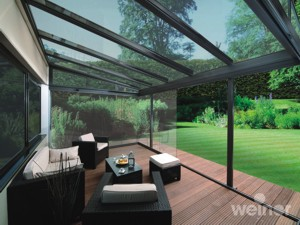 Awnings for you home retractable awnings from markilux for Garden glass room