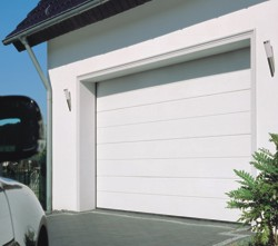 Carteck Centre Ribbed Sectional Garage Door located on a driveway