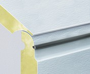 Sectional door panels have a seal inbetween each panel