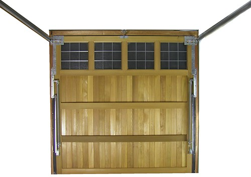 Timber garage door with up and over retractable gear