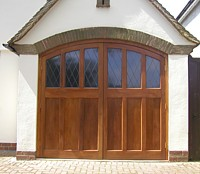 purpose made cedar door for arched garage opening