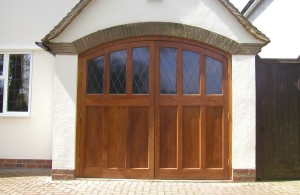 cedar side hinged timber bespoke garage door