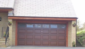 sectional cedar timber garage door driveway house