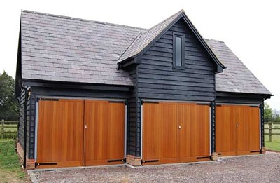 Side-hinged timber doors on triple garage - Cedar