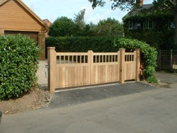 Automatic Iroko swing gates at Priors Hardwick, Northamptonshire