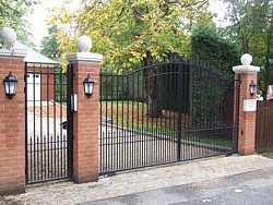 Pair of steel swing gates and matching side gate in Cambridgeshire