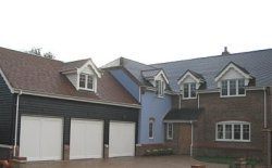 Three Cotswold Bourton up and over garage doors in Bedfordshire