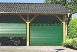 Pair green Seceuroglide automatic roller garage doors with vision slats