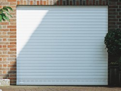 White roller shutter garage door with ventilation slats to help air circulation
