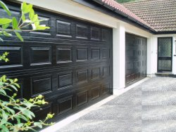 Pair of black finished georgian panelled sectional doors