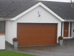 Ribbed sectional garage door in decograin golden oak to provide a natural wooden effect