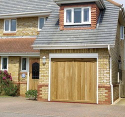 timber garage doors in oak and idigbo