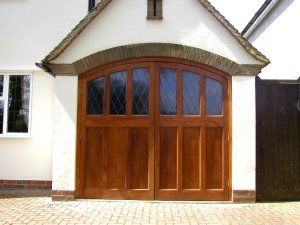 Purpose made side hinged timber garage doors with glazing in Bedfordshire
