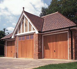 Triple garage with Garage Light and 2 Berkeley Vertical cedar timber garage doors
