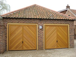 Pair of Hormann chevron cedar timber garage doors in Nottingham