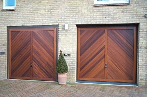 Pair of Hormann chevron cedarwood timber garage doors in Titchmarsh, Northants