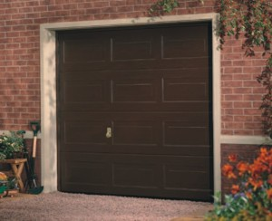 Garador Sectional Garage Door Georgian Woodgrain Design on house driveway