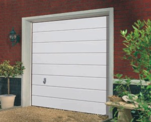 Garador Sectional Garage Door Medium Linear Design on house driveway