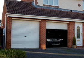 Gliderol Roller Shutter door offering security to both household and high value vehicle