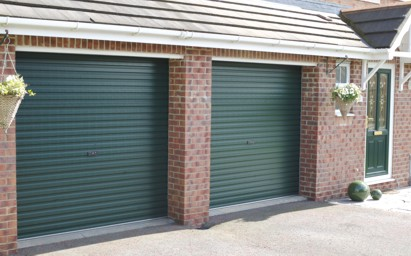 Gliderol roller shutter garagedoor installed on brick surface in green