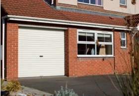 white steel aluminium single roller shutter garage door on house