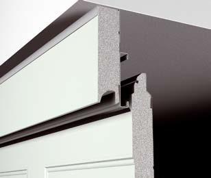 Insulated sectional door infill fascia