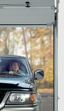 Sectional overhead garage doors from the garage door centre uk for Drive through garage door