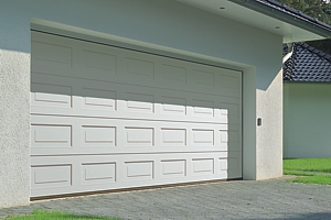 Panelled double sectional garage in white powdercoat finish with external keypad for electric operation