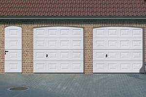 Matching twin georgian style sectional garage doors with matching panelled side door