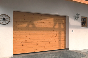 Timber sectional garage door with exterior keypad for electric operation
