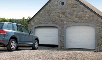hormann steel sectional white twin garage door in arches with jeep