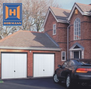 twin garage doors on a detached house in white finish