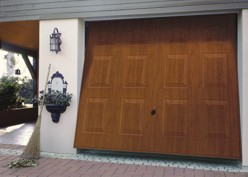 hormann georgian up and over garage door in decograin golden oak natural timber wood finish