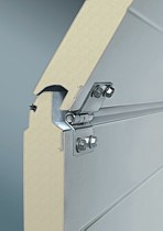insulated sectional door panels with finger trap protection