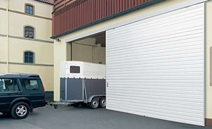 sliding garage door with horse trailier