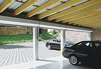 triple garage with roller shutters