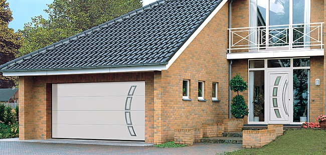 designer sectional door with stainless steel elements and matching entrance door