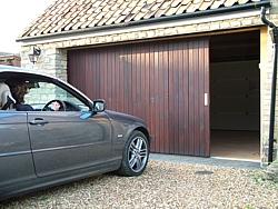 Vertically boarded side sectional garage door