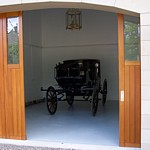 side sectional with windows in arched opening garage