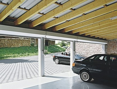 Triple garage with Seceuroglide doors open