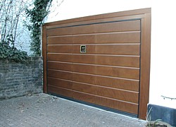 Sectional doors vertical or horizontal opening garage for Garage door opens on its own