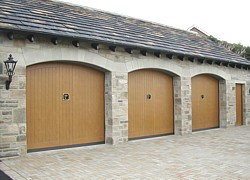 DOC non protruding garage doors  in arched openings