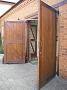 electrically operated side hinged garage doors