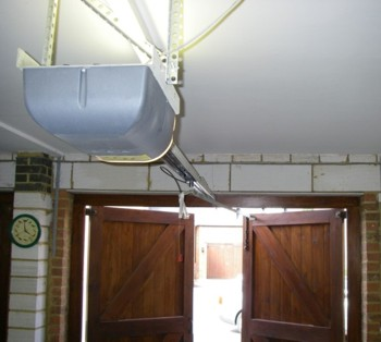 side hinged garage door operator system