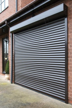steel roller shutter garage door in brown with external shutterbox on outside