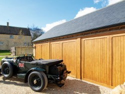 Idigbo timber garage doors in a triple garage opening