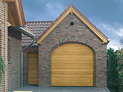 Hormann LTH S Ribbed Nordic Pine sectional timber garage door in arched opening