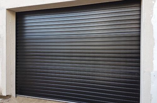 Steel roller shutter garage door installation by The Garage Door Centre