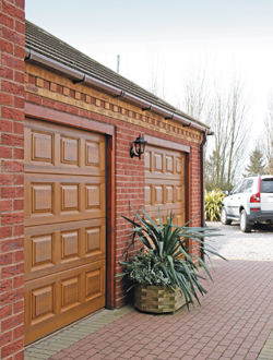 Wessex Vienna sectional garage doors in Honey Beech colour