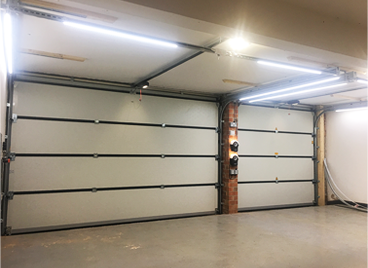 Sectional garage door and LED light strips installed by The Garage Door Centre